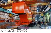 Industrial production plant - workers making an orange big detail of crane. Стоковое видео, видеограф Константин Шишкин / Фотобанк Лори