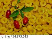 Ripe yellow peeled cherry plum and rosehip fruit. Natural background. Стоковое фото, фотограф Сергей Трофименко / Фотобанк Лори