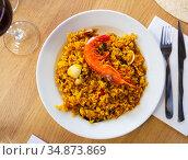Paella with seafood - traditional Spanish dish. Стоковое фото, фотограф Яков Филимонов / Фотобанк Лори