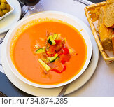 Spanish cold soup gazpacho in bowl with tomatoes and cucumber. Стоковое фото, фотограф Яков Филимонов / Фотобанк Лори