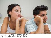 Unhappy couple lying on bed not speaking. Стоковое фото, агентство Wavebreak Media / Фотобанк Лори