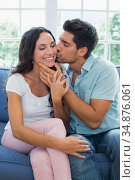 Boyfriend kisses attractive girlfriend on the cheek. Стоковое фото, агентство Wavebreak Media / Фотобанк Лори