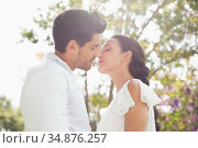 Attractive couple going into kiss each other. Стоковое фото, агентство Wavebreak Media / Фотобанк Лори