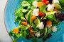 Salad of of hake with fresh lettuce leaves, lemon and vegetables. Стоковое фото, фотограф Яков Филимонов / Фотобанк Лори