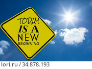 Composite image of today is a new beginning message on a sign. Стоковое фото, агентство Wavebreak Media / Фотобанк Лори