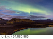 Northern lights (Aurora Borealis) over the Blautaver lake, Southern Iceland. October 2017. Стоковое фото, фотограф Espen Bergersen / Nature Picture Library / Фотобанк Лори
