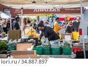 Local Vendors at the Waverly Market, Baltimore, Maryland. Редакционное фото, фотограф Edwin Remsberg / age Fotostock / Фотобанк Лори