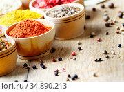 Mixed spices on wooden table set. Стоковое фото, фотограф Olena Mykhaylova / easy Fotostock / Фотобанк Лори