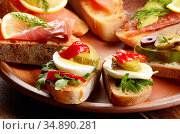 Open sandwiches with salmon, eggs and mussels on ceramic plate. Стоковое фото, фотограф Olena Mykhaylova / easy Fotostock / Фотобанк Лори