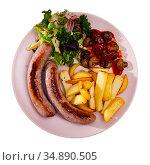 Fried sausages with baked potatoes, mushrooms and lettuce. Стоковое фото, фотограф Яков Филимонов / Фотобанк Лори