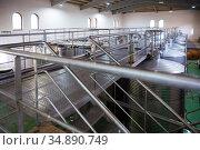 Interior of winery with stainless steel tanks. Стоковое фото, фотограф Яков Филимонов / Фотобанк Лори