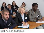 Group of business people listening to presentation. Стоковое фото, фотограф Яков Филимонов / Фотобанк Лори