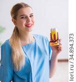 Young doctor nurse with tooth model. Стоковое фото, фотограф Elnur / Фотобанк Лори
