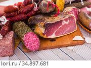 Variety of meats on table. Стоковое фото, фотограф Яков Филимонов / Фотобанк Лори