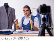 Young male tailor recording video for his blog. Стоковое фото, фотограф Elnur / Фотобанк Лори