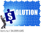 Solution concept with businessman solving jigsaw puzzle. Стоковое фото, фотограф Elnur / Фотобанк Лори