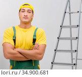 Repairman in coveralls in DIY concept. Стоковое фото, фотограф Elnur / Фотобанк Лори