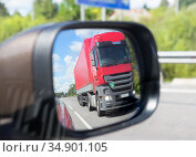 Truck reflection in a car mirror. Стоковое фото, фотограф Юрий Бизгаймер / Фотобанк Лори