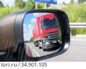Truck reflection in a car mirror. Стоковое фото, фотограф Юрий Бизгаймер / Фотобанк Лори