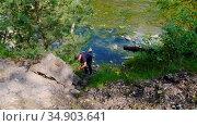 05-08-2020 KAZAN, RUSSIA: a man walking down the rock hill. Редакционное видео, видеограф Константин Шишкин / Фотобанк Лори