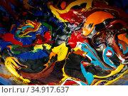 Berlin, Germany, paint residues in a bucket. Редакционное фото, агентство Caro Photoagency / Фотобанк Лори