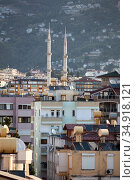The Alanya cityscape with minarets of mosque and residential houses in center of city. Antalya Province, Turkey. Стоковое фото, фотограф Кекяляйнен Андрей / Фотобанк Лори