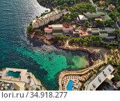Aerial view green transparent water bay of Mediterranean Sea nd luxury coastal villas. Majorca, Spain (2018 год). Стоковое фото, фотограф Alexander Tihonovs / Фотобанк Лори