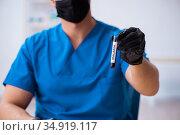 Young male biochemist testing blood samples. Стоковое фото, фотограф Elnur / Фотобанк Лори