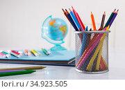 Closeup of color pencils, wax chalks, globe and notebooks. Стоковое фото, фотограф Яков Филимонов / Фотобанк Лори