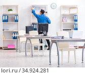 Handsome businessman employee sitting at his desk in office. Стоковое фото, фотограф Elnur / Фотобанк Лори