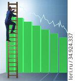 Businessman climbing towards growth in statistics. Стоковое фото, фотограф Elnur / Фотобанк Лори