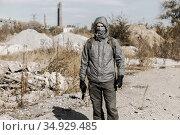 dangerous man stalker in a mask, hooded, holding a gun in his hand. Стоковое фото, фотограф Владимир Арсентьев / Фотобанк Лори