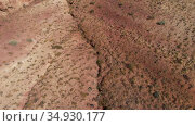 Amazing aerial video of the textured yellow and red mountains resembling the surface of Mars in Altai mountains. Стоковое видео, видеограф Jan Jack Russo Media / Фотобанк Лори