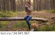 asian woman with mushrooms drinking tea in forest. Стоковое видео, видеограф Syda Productions / Фотобанк Лори