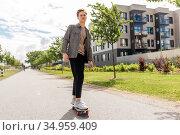 teenage boy on skateboard on city street. Стоковое фото, фотограф Syda Productions / Фотобанк Лори