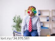 Funny employee clown working in the office. Стоковое фото, фотограф Elnur / Фотобанк Лори