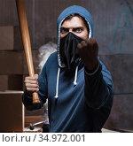Hooligan with bat in dark room. Стоковое фото, фотограф Elnur / Фотобанк Лори