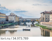 View of the river Arno, Ponte Vecchio bridge and pleasure boats in Florence in the evening in watercolor tones (2018 год). Стоковое фото, фотограф Сергей Фролов / Фотобанк Лори