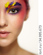 Unusual female face art make-up with paint on brows and around eyes. Стоковое фото, фотограф Serg Zastavkin / Фотобанк Лори