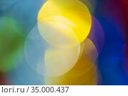 Christmas ornament decorations, vivid defocused abstract blurry bokeh background green, yellow, blue color. Стоковое фото, фотограф А. А. Пирагис / Фотобанк Лори
