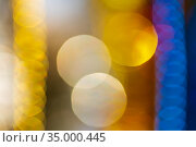 Bright defocused abstract blurry bokeh background. Christmas ornament decorations yellow and blue color. Стоковое фото, фотограф А. А. Пирагис / Фотобанк Лори