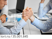 close up of businesspeople arm wrestling at office. Стоковое фото, фотограф Syda Productions / Фотобанк Лори