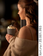 woman holding mug with whipped cream at night. Стоковое фото, фотограф Syda Productions / Фотобанк Лори