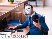 Young male employee wearing mask in the office. Стоковое фото, фотограф Elnur / Фотобанк Лори