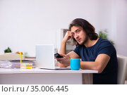 Young man employee working from house. Стоковое фото, фотограф Elnur / Фотобанк Лори