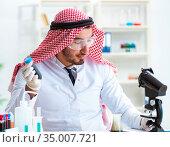 Arab chemist scientist testing quality of oil petrol. Стоковое фото, фотограф Elnur / Фотобанк Лори