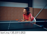 Woman at the net, table tennis, ping pong player. Стоковое фото, фотограф Tryapitsyn Sergiy / Фотобанк Лори
