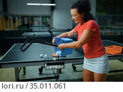 Woman with basket of ping pong balls, table tennis. Стоковое фото, фотограф Tryapitsyn Sergiy / Фотобанк Лори