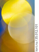 Beautiful defocused abstract blurry bokeh background yellow color. Festive Christmas lens flare photo effect. Стоковое фото, фотограф А. А. Пирагис / Фотобанк Лори