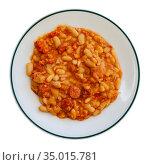 Appetizing braised beans with chorizo sausage pieces. Стоковое фото, фотограф Яков Филимонов / Фотобанк Лори
